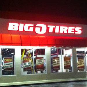 Big O Tires Lit Up Sign